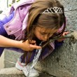Child drinking water from a fountain — Stock Photo #54047325