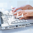 Hands of woman typing on the laptop — Stock Photo #64215401