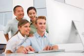 Multi ethnic group of people looking computer — Stock Photo