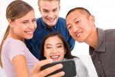Group of multiethnic friends taking self portrait — Stock Photo