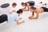 Young multi ethnic people exercising in gym — Stock Photo