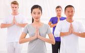 Multi ethnic group of happy people doing yoga — Stock Photo