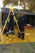 Black African Fireman displaying protective clothing — Stock Photo