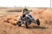Quad Bike kicking up trail of dust on sand track during rally ra — ストック写真
