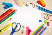 School supplies with blank paper on the school desk — Stock Photo