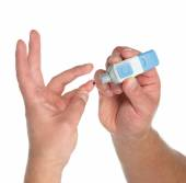 Diabetes lancet in hand prick finger to make punctures — Stock Photo