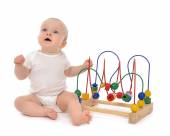 Infant child baby toddler standing playing wooden educational to — Stock Photo