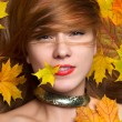 Fashion style woman smiling holding autumn yellow maple leaf in  — Stock Photo #54328203