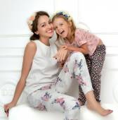 mother and four years old daughter laughing together hugging sm — Stock Photo