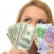 Happy young woman holding up cash money dollars and euros — Stock Photo #67843029