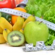 Diet weight loss breakfast concept with tape measure organic gre — Stock Photo #67843087