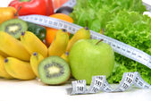 Diet weight loss breakfast concept with tape measure organic gre — Stock Photo