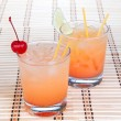 Alcohol margarita cocktails or long island Iced tea with lime in — Stock Photo #69569443