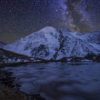 Magic night landscape with mountains, frozen lake and amazing st — Stock Photo #65966967