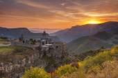 The ancient monastery in the setting sun. Tatev. Armenia. — Stock Photo