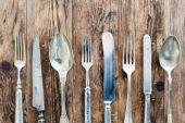 Spoon knife and fork on the wooden board. — Stock Photo