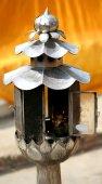Beautiful candlestick with burning candle — Stock Photo