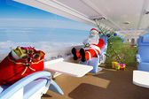 Santa in the plane. — Stock Photo