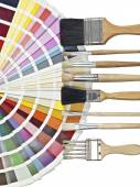 Palette and several paintbrushes isolated on white background — Foto de Stock