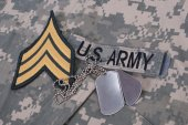 Us army uniform with blank dog tags and sergeant rank patch — Stock Photo