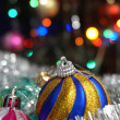 Christmas balls on the background of colored lights — Stock Photo #63752299