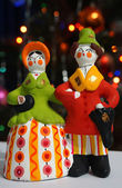 Clay Dymkovo toy on the background of Christmas lights — Stock Photo
