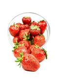 Strawberry trickling through the  plate — Stock Photo