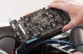 Male hands cleaning the video card — Stock Photo