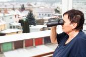 Senior woman with binoculars — Stock Photo