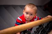 Scared child on stairs — Stock Photo