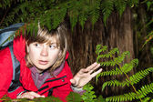 Scared woman backpacker lost in dark forest  — Stock Photo