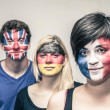 People with painted European flags on faces — Stock Photo #53513315