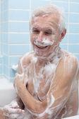 Happy senior man bathing — Stock Photo