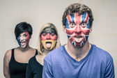 Funny people with European flags on faces — Stock Photo