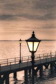 Vintage streetlamp on the coast — Stock Photo