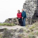Happy senior couple hiking on rocky terrain — Stock Photo #68905823
