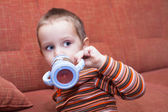 Child boy drinking — Stock Photo