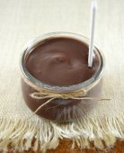 Chocolate yogurt on table — Stock Photo