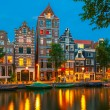 Night city view of Amsterdam canal with dutch houses — Stock Photo #51860563