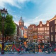 Night city view of Amsterdam canal, church and bridge — Stock Photo #53612897
