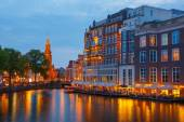 Night city view of Amsterdam canal,  and bridge — Stock Photo