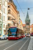 Red tram near Jindrisska Tower in Prague, Czech  — Стоковое фото