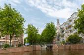 City view of Amsterdam canal, church and typical houses, Holland — Stockfoto