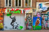 Urban graffiti on a dilapidated house on the street Spui in Amst — Stock Photo
