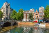 City view of Amsterdam canal, bridge and typical houses, Holland — Stock Photo
