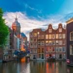 Evening Amsterdam canal, church and bridge — Stock Photo #70685293