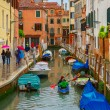 Tourists and the rowers on a rainy day in Venice — Stock Photo #74784969