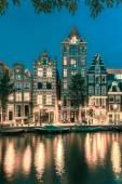 Noc amsterdamskich domki Holenderskie — Zdjęcie stockowe