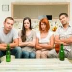 Upset friends watching tv — Stock Photo