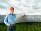 Engineer holding solar panel station plan — Stock Photo